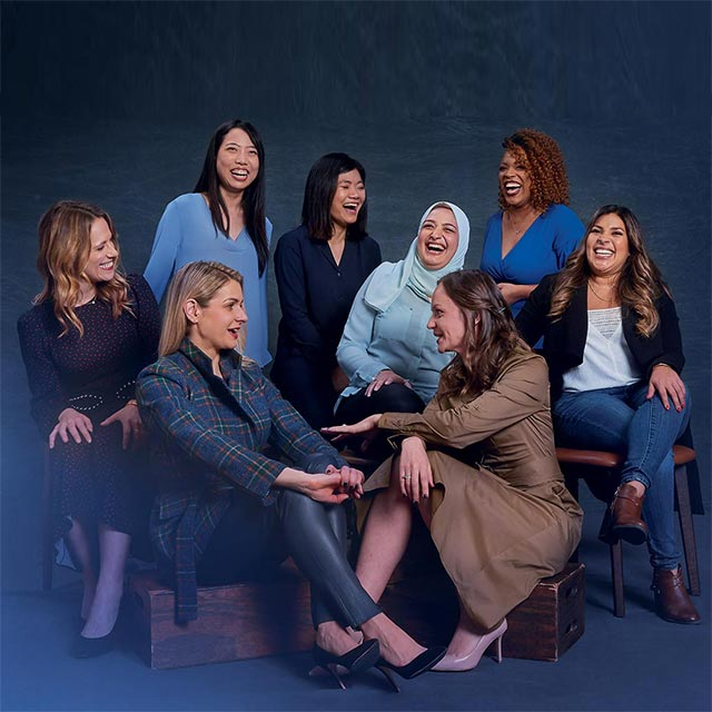 women entrepreneurs seated together laughing